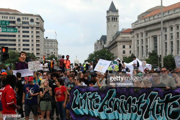 Counter protesters gather at Freedom Plaza before the Unite the Right rally in Lafayette Park across from the White House August 12 2018 in...