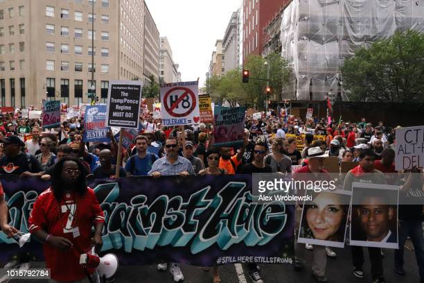 Counter protesters march from Freedom Plaza to Lafayette Park before the Unite the Right rally on August 12 2018 in Washington DC Thousands of...