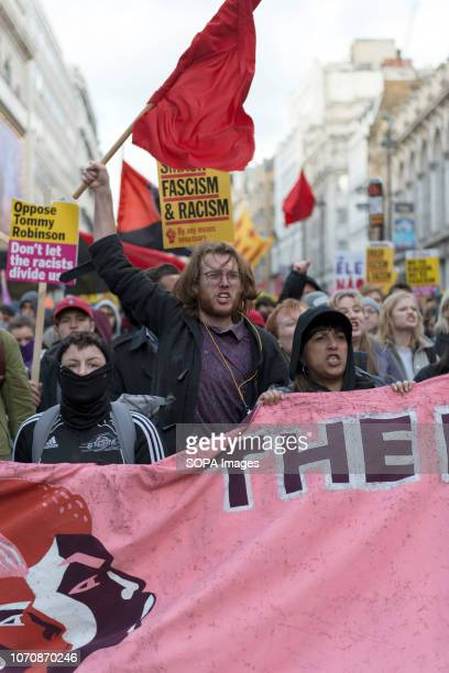 Counter protesters seen holding a banner and signs while shouting slogans during a demonstration against the 'Brexit Betrayal March' Thousands of...