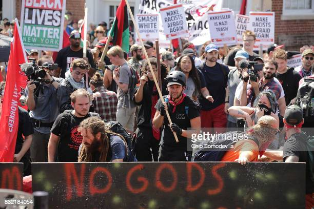 Counter protesters some called the antifa face down hundreds of white nationalists neoNazis KKK and members of the altright outside Emancipation Park...