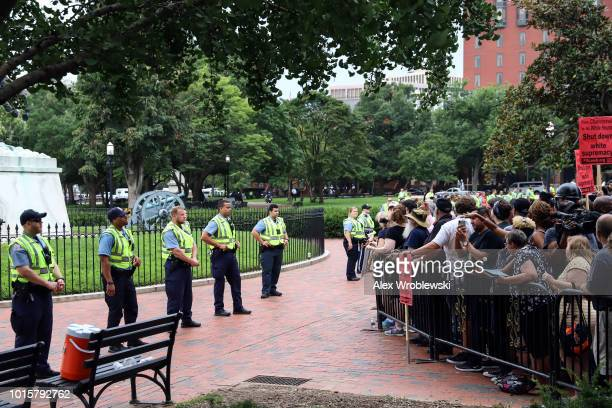 Counter protesters watch as white supremacists arrive to the Unite the Right rally on August 12 2018 in Washington DC Thousands of protesters are...