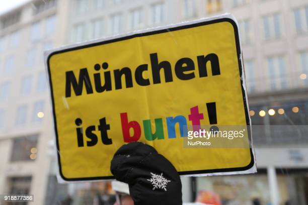 A counter protestor holds a sign saying quot Muenchen ist buntquot quotMunich is colourfulquot The racist Pegida movement started to rally again in...