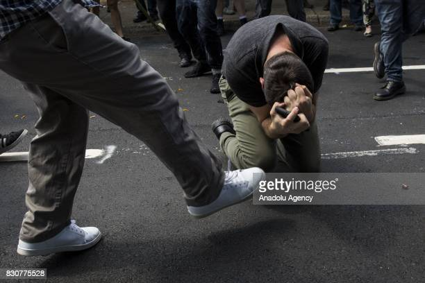 A counter protestor kicks a White Nationalist in the face during clashes at Emancipation Park where the White Nationalists are protesting the removal...