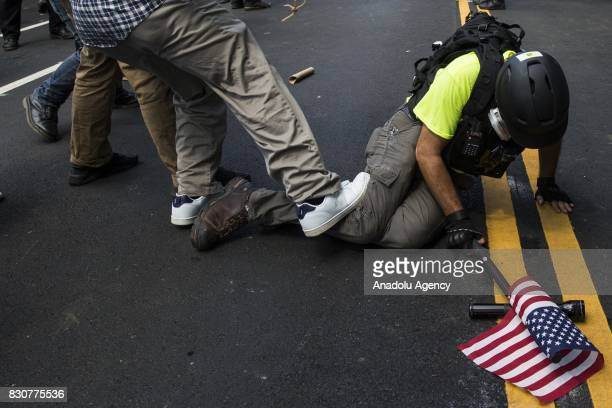 A counter protestor stomps on the leg of a White Nationalist during clashes at Emancipation Park where the White Nationalists are protesting the...