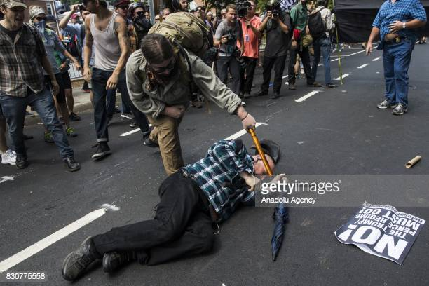 A counter protestor strikes a White Nationalist with a baton during clashes at Emancipation Park where the White Nationalists are protesting the...