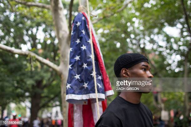 A Counter protestor to a farright rally stands with an American flag during the Unite the Right 2 Rally in Washington DC on August 12 2018 Last...