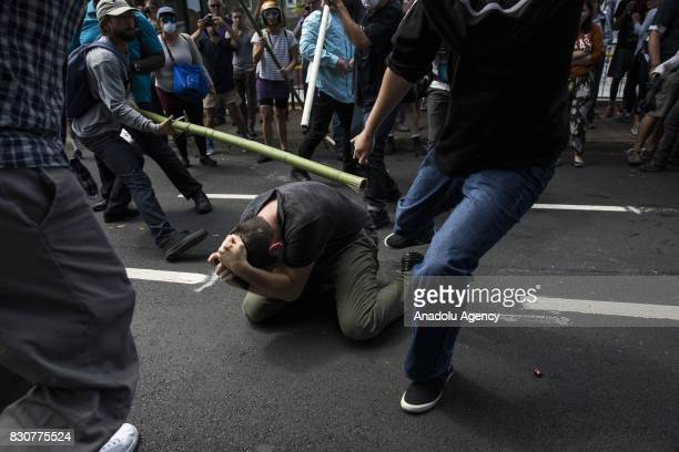 Counter protestors beat a White Nationalist during clashes at Emancipation Park where the White Nationalists are protesting the removal of the Robert...