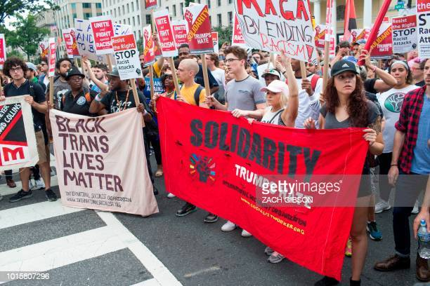 Counter protestors to a farright rally march during the Unite the Right 2 Rally in Washington DC on August 12 2018 Last year's protests in...