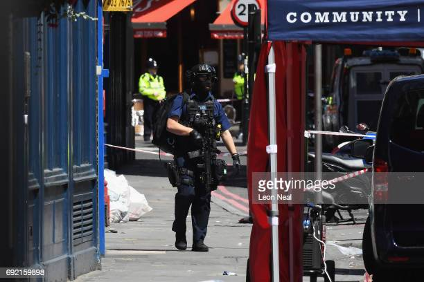 A counter terrorism officer walks near Tapas Brindisa restaurant on June 4 2017 in London England Police continue to cordon off an area after...