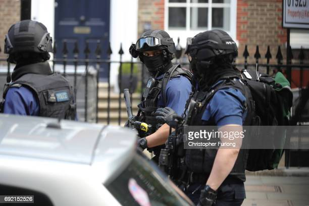 Counter terrorism officers are seen near the scene of last night's London Bridge terrorist attack on June 4 2017 in London England Police continue to...