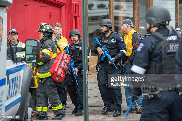 Counter terrorism officers carrying simulated machine guns participate in the drill. NYC first res-ponders from the NYPD and FDNY staged a...