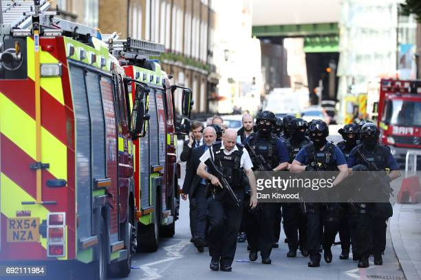 Counter terrorism officers march near the scene of last night's London Bridge terrorist attack on June 4 2017 in London England Police continue to...