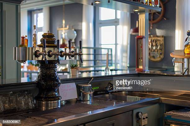 Counter with beer pump in restaurant