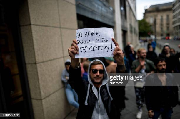 A counterdemonstrator holds a sign in the air in Berlin Germany on 16 September 2017 Under the motto quotProtect the most vulnerable yes to every...