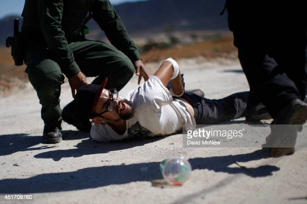Counter-demonstrator to protesters opposing arrivals of buses carrying largely women and children undocumented migrants for processing at the...
