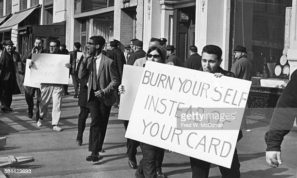 Counterdemonstrators at an antiViet Nam War rally in Union Square New York New York November 6 1965 Among the visible signs are ones that read 'Burn...