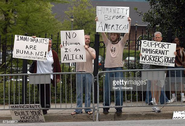 Counterdemonstrators display signs during an immigration rally on the steps of the state Capitol April 17 2006 in Atlanta Georgia About 300 people...