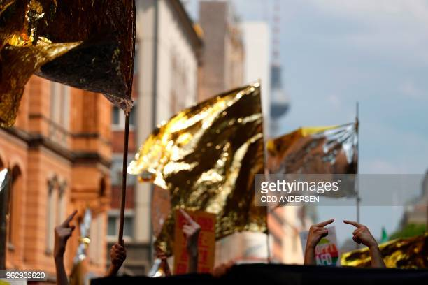 TOPSHOT Counterdemonstrators give their middle fingers as Alternative for Germany 's demonstrators march in Berlin during the demonstration for the...
