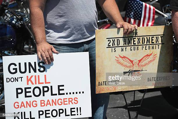 Counterdemonstrators show support for DSA Inc as antigun demonstrators protest outside the gun manufacturing facility on June 17 2016 in Lake...