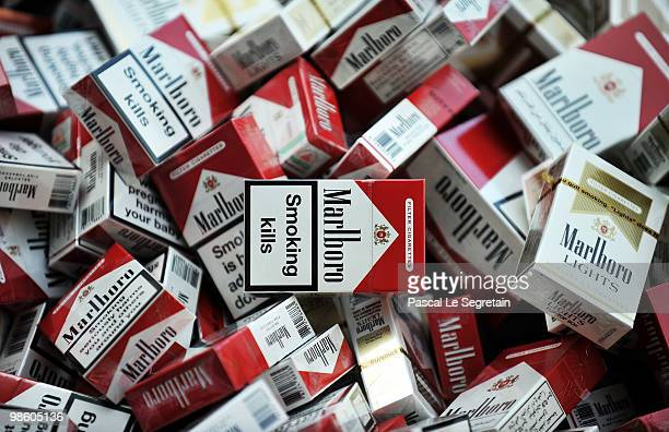 Counterfeit cigarettes seized by Customs are displayed outside Ministere des Finances on April 22 2010 in Paris France France's Budget Minister...