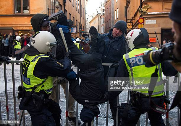 A counterprotester is arrested by the police as they keep them away from the neoNazi Nordic Resistance Movement's 's sympathizers after a...
