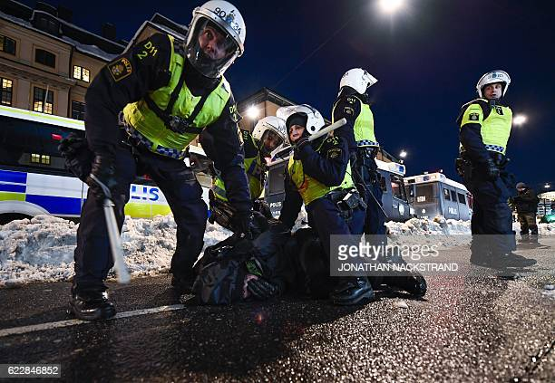 A counterprotester is arrested by the police as they keep them away from The Nordic Resistance Movement's Nordiska motstandsrorelsens after a...