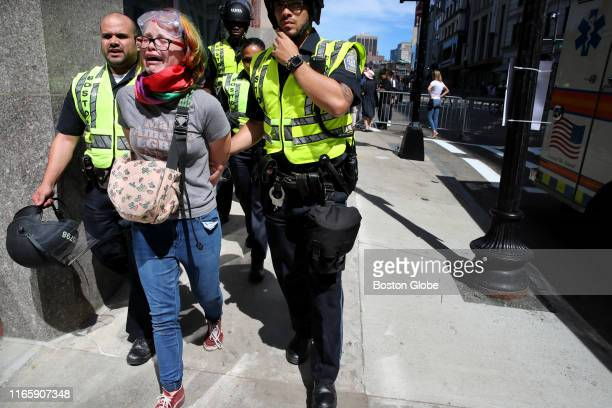 A counterprotester is taken into custody at Boston Common during the Straight Pride Parade on Aug 31 2019 In dueling demonstrations about a mile...