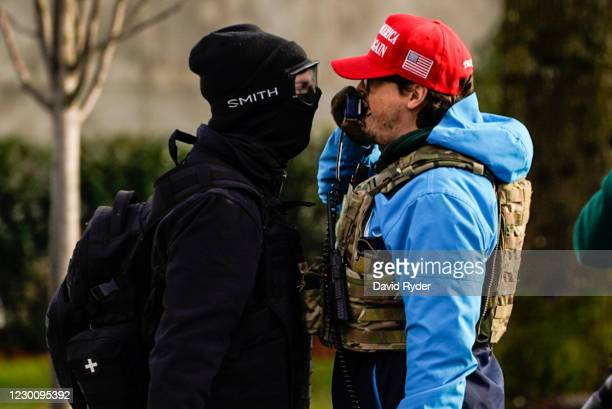 Counter-protester taunts a supporter of President Donald Trump during political clashes on December 12, 2020 in Olympia, Washington. Far-right and...