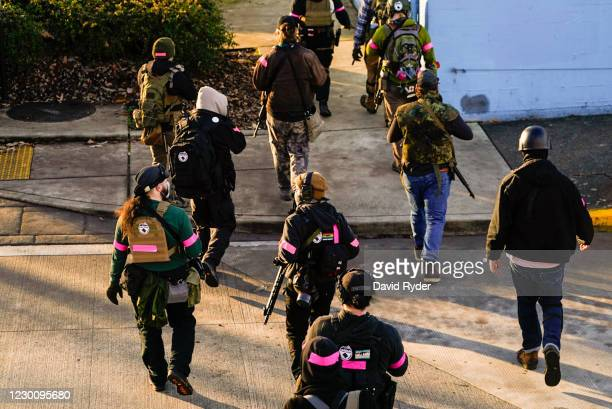 Counter-protesters carry weapons during political clashes between Trump supporters and counter-protesters on December 12, 2020 in Olympia,...
