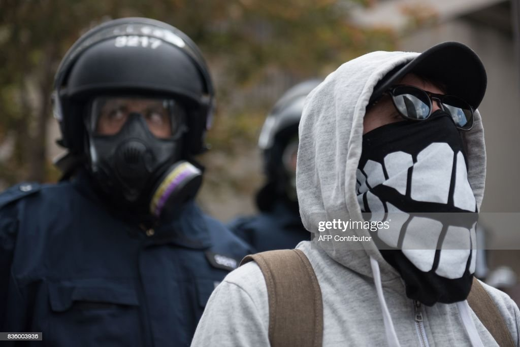 Counter-protesters demonstrate in Quebec City, Canada, on August 21, 2017. Clashes erupted Sunday between police and dozens of anti-racist activists on the sidelines of a pro-immigration rally in Quebec City while a demonstration organized by extreme-right activists gained little traction. In a bid to keep the two rallies apart, police erected a security cordon but declared the anti-racist demonstration illegal after sporadic clashes broke out and hooded individuals threw projectiles at police. PHOTO / Alice Chiche
