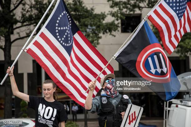 Counterprotesters gather at Freedom Plaza before the Unite the Right rally in Lafayette Park across from the White House August 12 2018 in Washington...