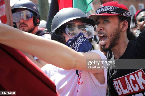 Counterprotesters hold a line against white nationalists neoNazis and members of the 'altright' near the entrance to Emancipation Park during the...