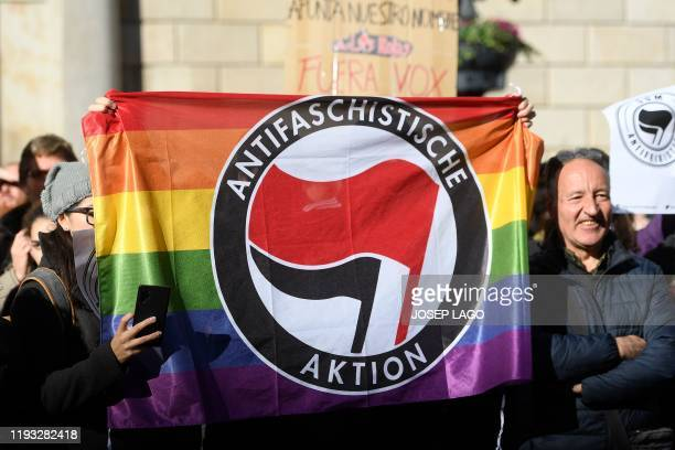 Counterprotesters holds a flag of the antifascist party Aktion in Barcelona on January 12 2020 during a rally by supporters of Spanish farright VOX...