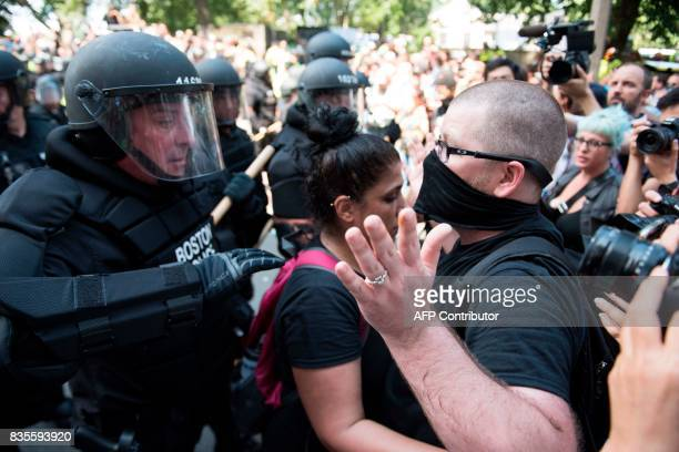 Counterprotesters of the Boston 'Free Speech' Rally clash with police as they are moved back at Boston Commons on August 19 in Boston Thousands of...