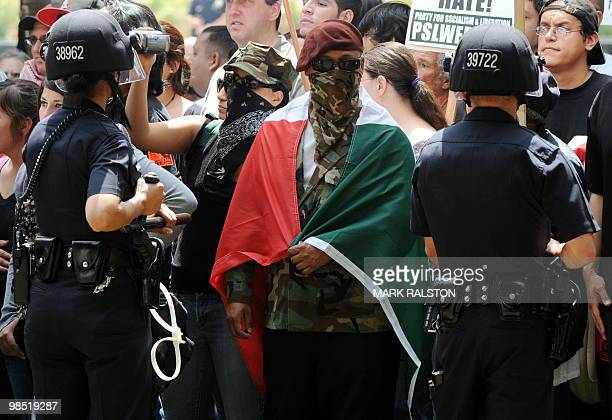 Counterprotesters stand behind a LAPD police line as members of the neonazi group The American National Socialist Movement hold a rally in front of...