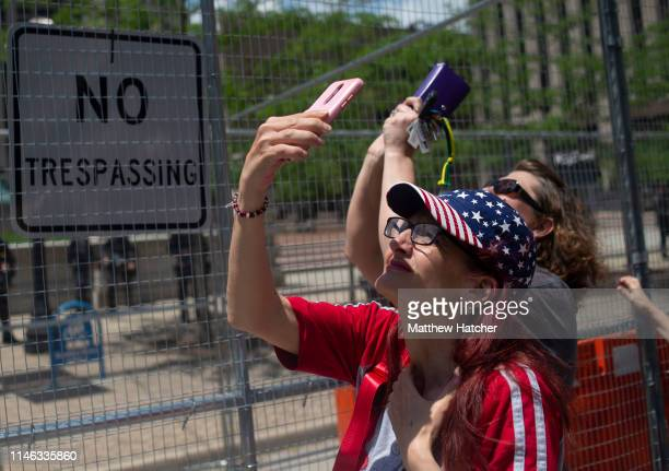 Counterprotesters wave flags signs and rock body paint as they counterprotest a rally held by the KKK affiliated group Honorable Sacred Knights of...
