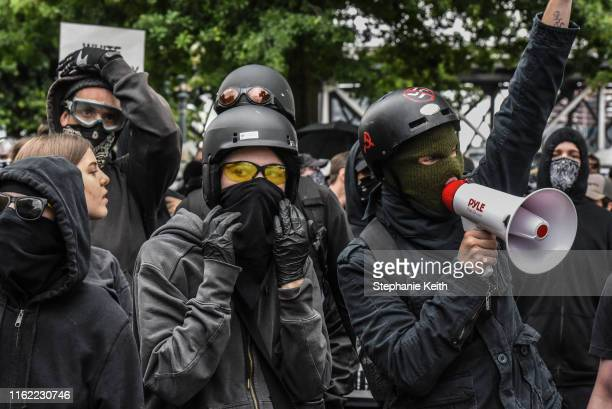 Counterprotesters wear black clothes during an Antifa gathering during an altright rally on August 17 2019 in Portland Oregon Antifascism...