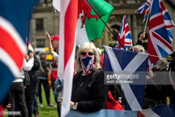 Counter-protesters with Union flags face off against pro-independence protesters gathering in George Square, Glasgow on May 1 ahead of the upcoming...
