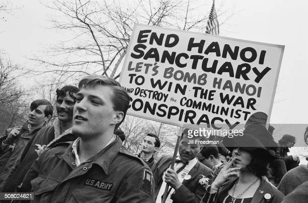 Counterprotestors attend a peace demonstration in New York City during the Vietnam War USA 1967 They are advocating the bombing of Hanoi to 'destroy...