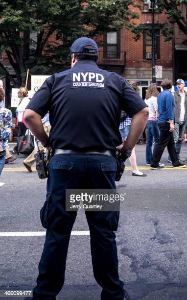 CONTENT] Counterterrorism NYPD officer on duty at the Atlantic Antic street fair in Brooklyn New York