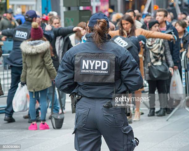 NYPD counterterrorism officer keeps an eye on the proceedings at a spectator checkpoint With a heightened degree of security due to the threat of a...