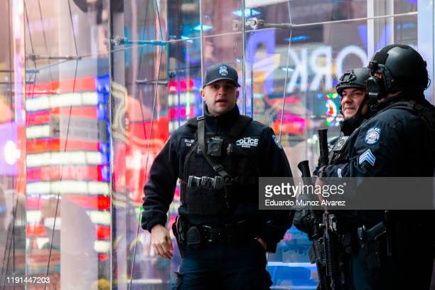 NYPD counterterrorism officers stand guard at Times Square on January 3 2020 in New York City The NYPD will take actions to protect the city and...