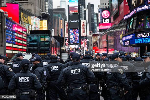 Counterterrorism police officers are briefed in Times Square prior to the Times Square new years eve celebration on December 31 2015 in New York City...