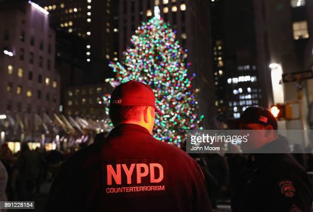 Counterterrorism police stand guard near the Christmas tree at Rockefeller Center on December 12 2017 in New York City Security in the city remained...