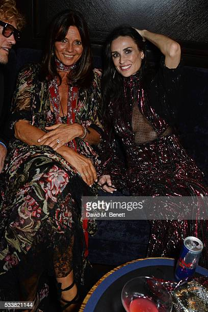 Countess Debonnaire von Bismarck and Demi Moore attend British Vogue's Centenary birthday party at Tramp on May 23 2016 in London England