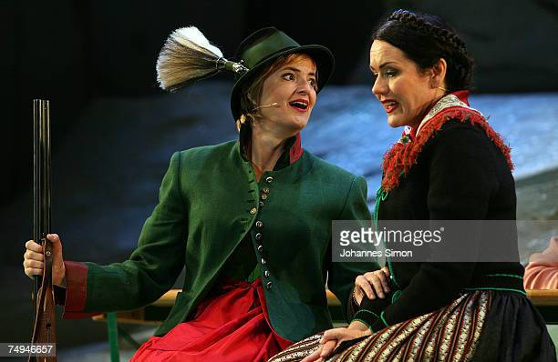 Countess Gloria von Thurn und Taxis and singer Anjara Bartz perform on stage during the rehearsal of the operetta Weisses Roessl prior to the Thurn...