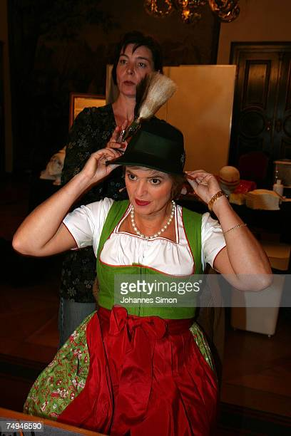 Countess Gloria von Thurn und Taxis is dresses by a make up artist prior to the rehearsal of the operetta Weisses Roessl during the Thurn und Taxis...