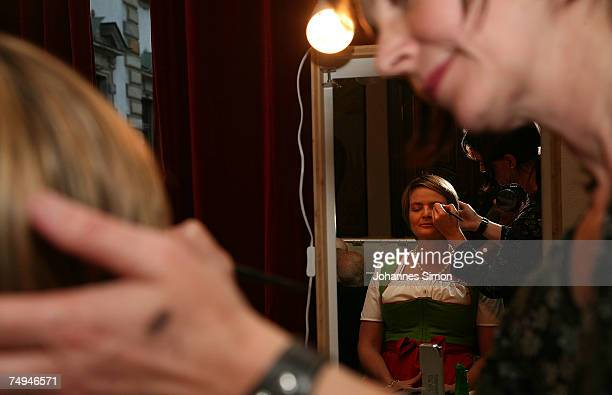 Countess Gloria von Thurn und Taxis is painted by a make up artist prior to the rehearsal of the operetta Weisses Roessl during the Thurn und Taxis...