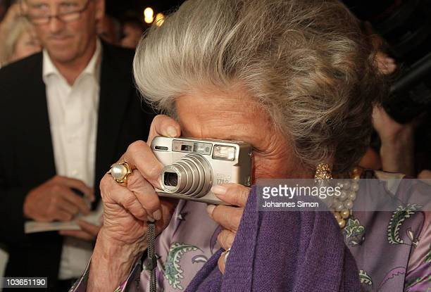 Countess Marianne zu SaynWittgensteinSayn takes a photo after the Pakistan Benefit Concert at Haus fuer Mozart cponcert hall on August 26 2010 in...