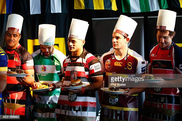 Counties Manukau captain Augustine Pulu and Southland captain John Hardie hold their burgers following a hamburger making competition during the ITM...